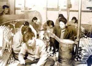 Making bamboo umbrella in 1960s